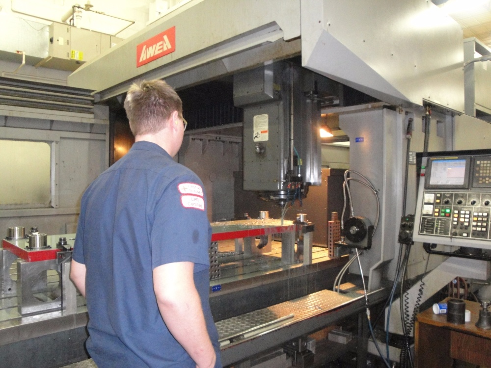 CNC Operator Inspecting Machine Tool Milwaukee